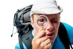 Grappige ontdekkingsreiziger met een grappige fotolens op een wit Royalty-vrije Stock Afbeelding