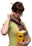 Grappige student met een woordenboek Stock Afbeelding