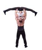 Grappige super die acrobaten, op wit worden geïsoleerd Stock Foto's