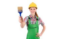 Grappige vrouwenschilder in geïsoleerd bouwconcept Stock Foto's
