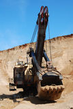 Grapple dredger. The dredge extracts sand in career Stock Image