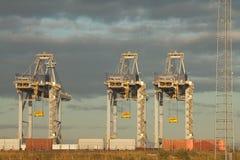 Grúas en puerto Foto de archivo