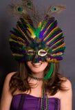gras mardi屏蔽微笑的妇女 图库摄影