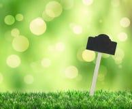 Gras mit Zeichen Stockfotografie