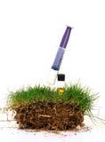 Gras- und Bodenbehandlung Stockbild