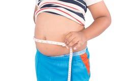 Grasa del muchacho con la cinta métrica Foto de archivo libre de regalías