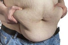 Grasa ipinching del vientre del hombre gordo Foto de archivo