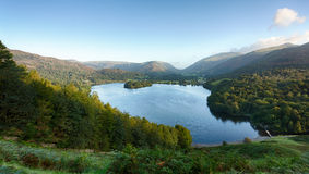 Grasmere at dawn in Lake District. Overlook of Grasmere in Lake District as sunrise as sun light mountains Stock Image