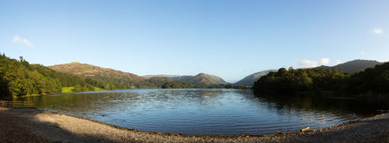 Grasmere at dawn in Lake District. Panorama of Grasmere in Lake District as sunrise as sun light mountains Royalty Free Stock Images