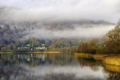 Grasmere lake. Scenic view of Grasmere lake shrouded in mist, Lake District National Park, Cumbria, England Stock Image