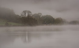 Grasmere, Lake District. Early morning mist over Grasmere, Lake District, Cumbria United Kingdom Stock Photography