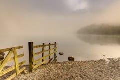 Grasmere Lake. Foggy sunrise at Grasmere Lake, Lake District Stock Photos