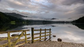 Grasmere Lake. Sunrise at Grasmere Lake, with a wooden fence Royalty Free Stock Image