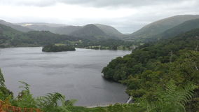 Grasmere lake view from viewpoint above. Landscape of Lake District mountains surrounding Grasmere lake.Shot from Loughrigg Terrace above the dam on Rothay river stock video footage