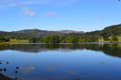 Grasmeremeer in het meerdistrict Engeland stock foto