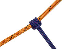 Grasp knot. On blue and orange ropes on white background Royalty Free Stock Photography