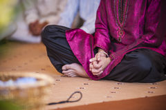Grasping Hand. Punjabi groom grasping hand while hearing preach Stock Photography