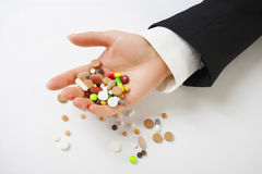 Grasping pills Royalty Free Stock Photography
