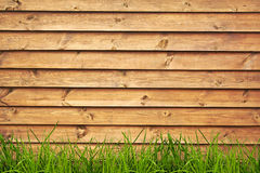 Grass. Wood textured backgrounds in a room interior on the grass backgrounds Royalty Free Stock Images