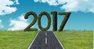2017 in grass against a composite image 3D of asphalt road in the sky Stock Images