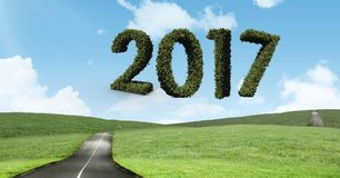 2017 in grass against a composite image 3D of road. Surrounded by grassland Royalty Free Stock Photo