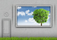 Grass amid the concrete wall with sky and tree in Royalty Free Stock Images