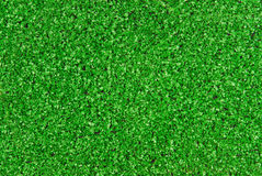 Grass artificial astroturf background. Closeup of the grass artificial astroturf background Royalty Free Stock Photo
