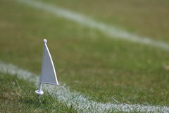 Grass athletics track showing flag marker. Grass athletics track showing white flag marker. School sports day in the summer royalty free stock images
