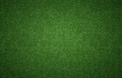 Grass Background Texture. Green grass background texture with grunge lighting and lots of copy space. Perfect for sport designs Royalty Free Stock Photos