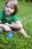 In The Grass Blowing Bubbles Stock Photo