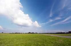 Grass and blue sky background stock photo