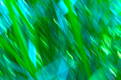 Grass blur lines with greens and blues Stock Images