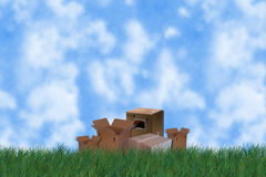 Grass with boxes royalty free stock photo