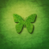 Grass butterfly. Shape on green sackcloth Royalty Free Stock Image