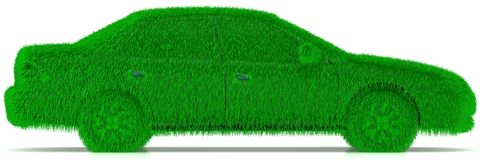 Grass covered car - eco green transport Stock Photo