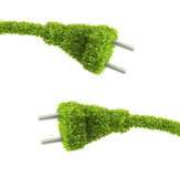 Grass covered electrical plug Stock Image