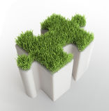 Grass covered puzzle piece Stock Photography