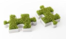 Grass covered puzzle pieces Stock Image