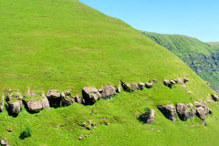 Grass-covered slope of a mountain Stock Photo