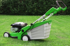 Grass cutter. On a green meadow Royalty Free Stock Photos