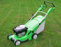 Grass cutter. Benzin grass cutter on a meadow Royalty Free Stock Photo
