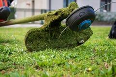 Grass cutter / brush cutter for trimming overgrown grass Stock Photo