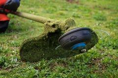 Grass cutter / brush cutter for trimming overgrown grass Stock Photos
