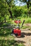 Grass cutter / brush cutter for trimming overgrown grass Royalty Free Stock Photos