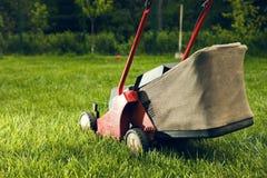 Grass cutter. On a green meadow Stock Photos