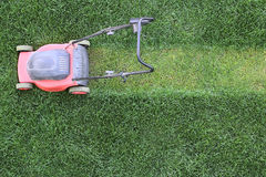 Grass cutter at the lawn Stock Images