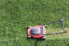 Grass cutter at the lawn Royalty Free Stock Images