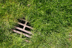 Grass and drain background Stock Image