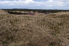 Grass dune and sommerhouses Royalty Free Stock Photos