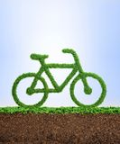 Grass eco bicycle concept. Grass growing in the shape of a bicycle, symbolising the need to invest in nature and a healthy lifestyle Royalty Free Stock Image